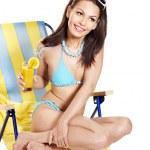 Girl in bikini drinking orange juice. — Stock Photo