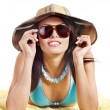 Girl in bikini and sunglasses on beach. — Stock Photo #9504543