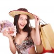 Woman with  money and shopping bag. — Stok fotoğraf