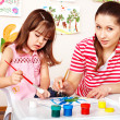 Stock Photo: Child painting with mother in preschooler.
