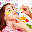 Stock Photo: Child with face painting.