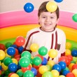 Birthday of boy in color balls. — Stock Photo