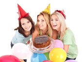 Group in party hat giving cake. — Stock Photo