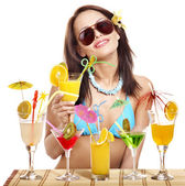 Girl in bikini on beach drinking cocktail. — Stock Photo