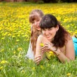Happy mother and daugter in park. — Stock Photo