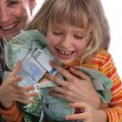 Stock Photo: A happy mother with a child holds a money.