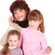 Grandmother and granddaughter talk on phone. — Stock Photo #9511417
