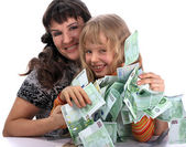 A happy mother with a child holds a money. — Stock Photo