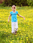 Child running in field. — Stock Photo