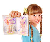 Child holding passport. Foreign vacation. — Stock Photo