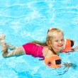 Child with armbands in swimming pool — Stock Photo #9862187