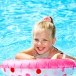 Child sitting on inflatable ring in swimming pool. — Stock Photo #9862188
