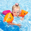 Child with armbands in swimming pool. — Stock Photo #9862192