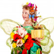 Stock Photo: Child with flower and butterfly.