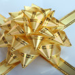 Gold bow and ribbon. - Stock Photo