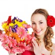 Young woman holding flowers. - Stock Photo
