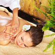 Young woman getting massage in spa. - Foto de Stock