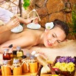 Woman getting thai herbal compress massage . - Foto de Stock