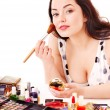 Stock Photo: Girl applying makeup.