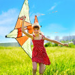 Child flying kite outdoor. - Stock Photo