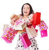 Woman holding gift box at birthday party. — Stock Photo
