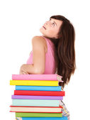 Girl with stack multicolored book . — Stock Photo