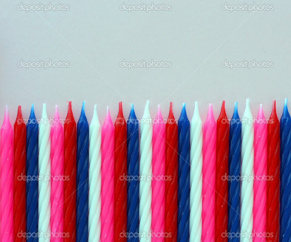 Row of birthday candles red white and blue — Stock Photo #10552111