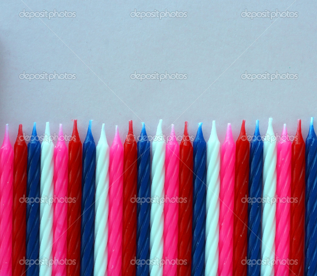 Row of birthday candles red white and blue — Stock Photo #9639281