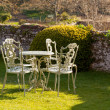 Garden table and chairs on lawn — Stok fotoğraf