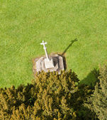 Carved cross from tower of Ludlow parish church — Stock Photo