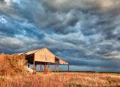 Deserted barn in storm — Stock Photo