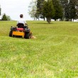 Senior man on zero turn lawn mower on turf — Stock Photo #10194423