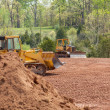 Large earth mover digger clearing land — Stock Photo #10194484