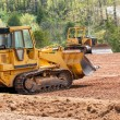 Large earth mover digger clearing land — Foto de Stock