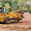Large earth mover digger clearing land — Stock Photo