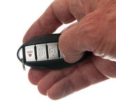 Thumb on keyless wireless door opener — Stock Photo