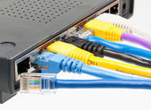 Cat 5 cables in multiple colors in router — Stock Photo