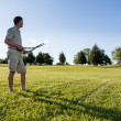 Senior man cutting grass with shears — Stock Photo