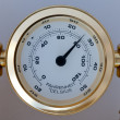Stock Photo: Gold colored thermometer
