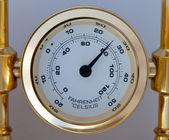 Gold colored thermometer — Stock Photo