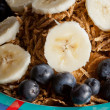 Slices of banana and blueberries on cereal — Stock Photo #8026115