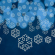 Snowflake shapes against tree lights — Stock Photo
