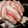 Bacon laid on turkey for roasting — Stock Photo