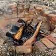 Old brick firepit - Stock Photo
