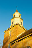 Warm sunlight on Bruton parish church tower — Stock Photo
