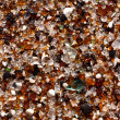 Closeup of glass fragments on beach — Stock Photo