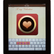 Love spelt out on keypad of pad — Stockfoto