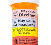 Warning signs on bottle of rx drugs — Stock Photo