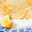 Pancake with lemon on blue plate — Stock Photo
