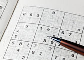 Pencil resting on sudoku book — Stok fotoğraf
